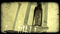 Candles and statue. Vintage stylized video clip.