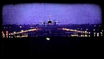 Plane lands on runway. Vintage stylized video clip.