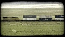 Freight train on prairie. Vintage stylized video clip.