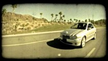 Silver car on highway. Vintage stylized video clip.