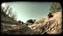 Jeep in dirt ditch. Vintage stylized video clip.