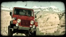 Jeep at top of a hill. Vintage stylized video clip.