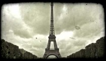 Front of Eiffel Tower. Vintage stylized video clip.