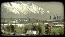 Busy city highways and mountains. Vintage stylized video clip.