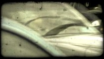 Busy traffic intersection. Vintage stylized video clip.