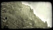 Mountain ledge 2. Vintage stylized video clip.