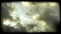 Blue fluffy clouds. Vintage stylized video clip.