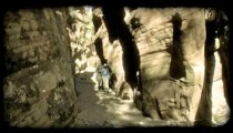 Couple hikes through canyon. Vintage stylized video clip.