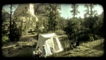 Couple camping. Vintage stylized video clip.