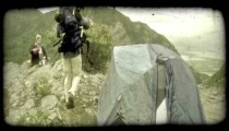 Couple prepare on mountain top. Vintage stylized video clip.