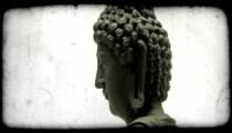 Tilting shot of a buddha. Vintage stylized video clip.