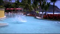 Slow motion shot of a man diving into a shallow pool.