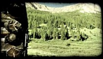 Old cabin in mountains. Vintage stylized video clip.