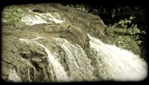 Edge of waterfall. Vintage stylized video clip.