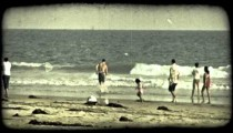 People play on beach. Vintage stylized video clip.