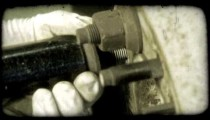 Bolts being removed. Vintage stylized video clip.