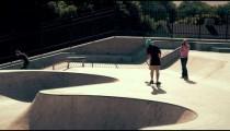 Shot of skater doing a few tricks at a skatepark.
