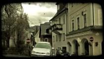 Car on European street. Vintage stylized video clip.