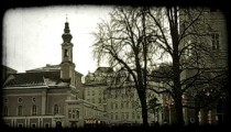 Street of Salzburg at dusk. Vintage stylized video clip.