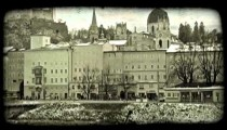 Pan of old town Salzburg. Vintage stylized video clip.