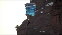 Slow-motion shot of base jumper going in for landing.