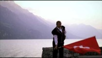 Man artfully twirls and throws Swiss flag