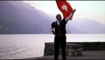 Man artfully twirls and tosses Swiss flag