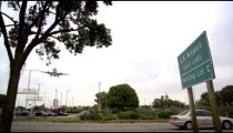 Slow-motion shot of vehicles driving in and out of parking lot c at LAX.