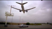 Low-angle shot of airplane flying into LAX