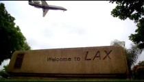 "Plane flies over ""Welcome to LAX"" sign"