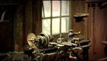 Racking-focus footage of a strange, old-looking machine