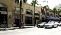 Sped-up shot of buildings along Hollywood Blvd. California