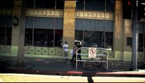 Slow motion dolly shot of buildings along Hollywood Blvd. in California