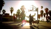 Basketball game in slow motion with lens flare shot near Venice Beach, California