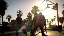 Lens flare shot of basketball game near Venice Beach, California filmed in slow motion