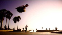 Slow motion shot of jumping rollerblader at Ocean Front Walk near Venice Beach, California