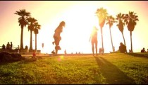 Slow motion lens flare shot of people strolling near Venice Beach, California