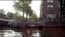 Sped-up shot of houseboats and streets in Amsterdam
