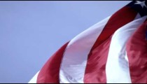 Shot of American flag waving and rolling in the breeze.