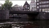 Passing by a bridge on a river in Amsterdam