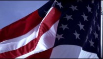View of American flag close up and flowing in the breeze.