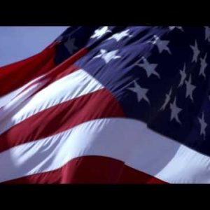 Shot of American flag close up and blowing in the wind.