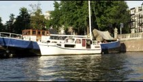 Houseboats along the embankment in Amsterdam