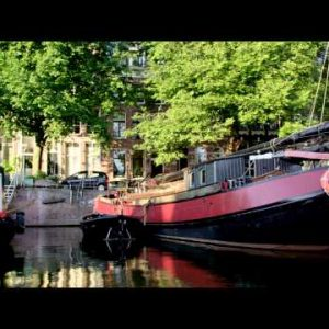 Shot of boats and houseboats along the embankment in Amsterdam