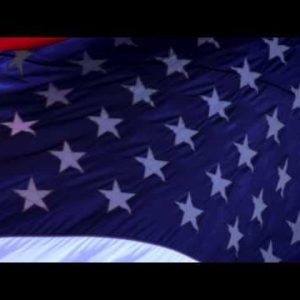 Close up of American flag waving in the breeze.