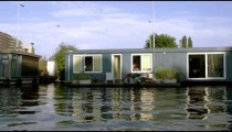 Shot of contemporary buildings and houseboats in Amsterdam