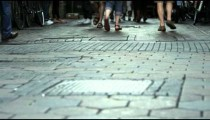 Shot of people's feet while walking on a sidewalk at Amsterdam