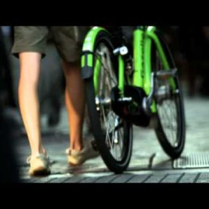 Handheld shot of people's legs and feet while walking on a sidewalk in Amsterdam
