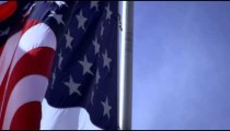 Up close shot of the American flag blowing in the wind.