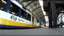 Timelapse shot of a train and its passengers in a train station in Amsterdam